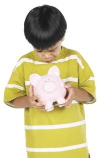 Picture of child with piggy bank