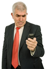 Man puzzled with mobile phone